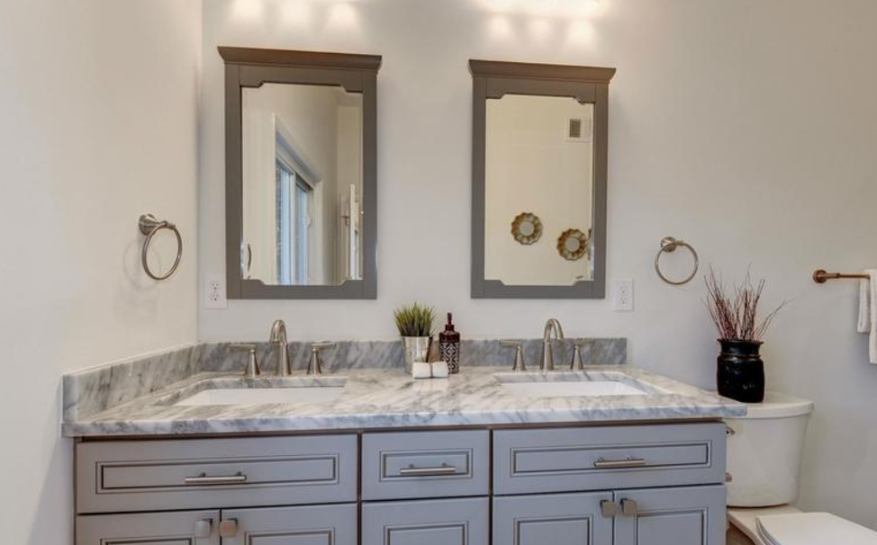 bathroom with dual vanities