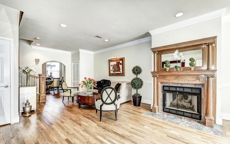 room with hardwood floors and a fireplace
